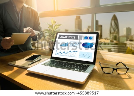 ANALYTICS (Analysis Analytic Marketing  Graph Diagram) Thoughtful male person looking to the digital tablet screen, laptop screen,Silhouette and filter sun - stock photo