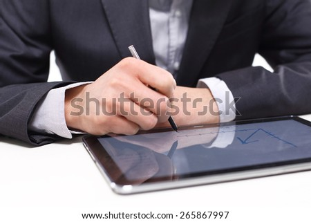 Analyzes and graphs. Jobs in banking. Hands of a man in a suit of a drawing on the tablet charts.  - stock photo