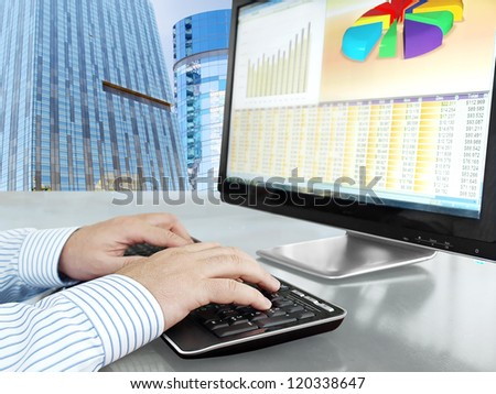 Analyzing Data on Computer Male Hands on the Keyboard in Front of Computer Screen with Financial Data and Charts - stock photo