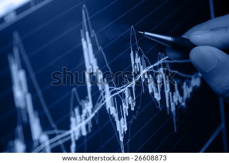 analyzing financial graph on screen - stock photo