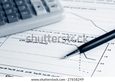 Analyzing of the stock exchange reports. - stock photo