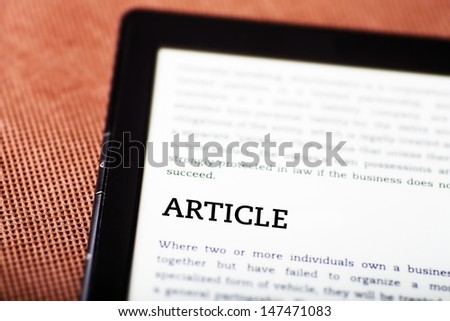 Analyzing on ebook, tablet pc concept - stock photo