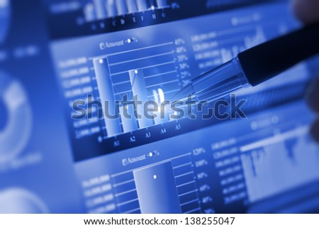 Analyzing stock market from computer screen. - stock photo