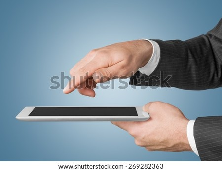 Analyzing. Touch screen ,touch- tablet in hands - stock photo