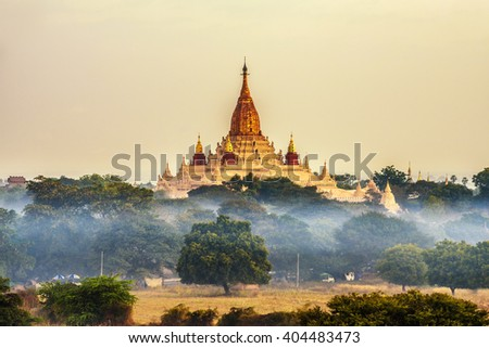 Ananda temple in Bagan at sunrise. Bagan is an ancient city in Myanmar (Burma) with thousands of historic buddhist temples and stupas. - stock photo