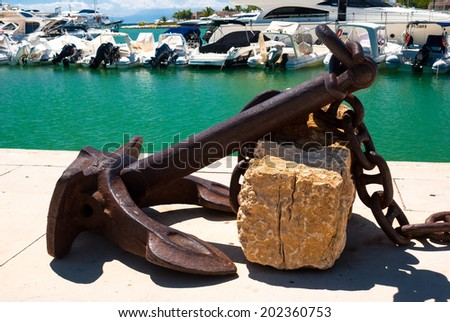 Anchor rest for decoration on a marina - stock photo