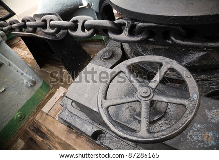 Anchor winch with chain - stock photo
