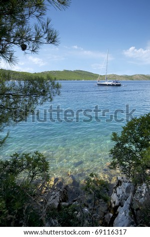 Anchored yacht in clear waters of the Mediterranean Sea - stock photo