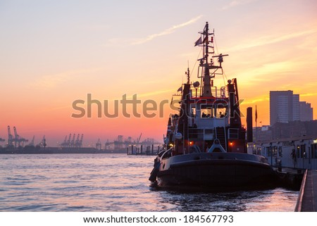 anchoring ship at the St Pauli Piers in Hamburg, Germany, at sunset - stock photo