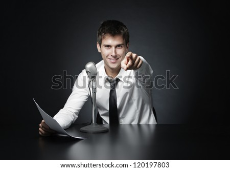 Anchorman smiling pointing at you - stock photo