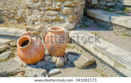 Ancient amphorae in the Old Town Nessebar, Bulgaria, Black sea - stock photo