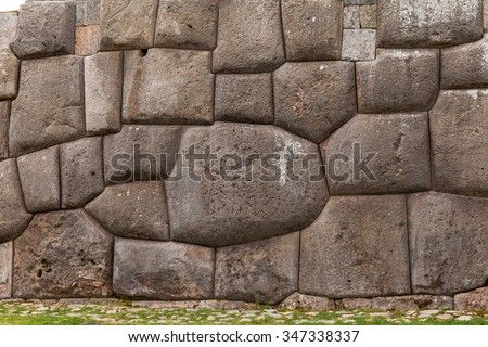 Ancient and mysterious stone wall in Sacsayhuaman Inca archaeological site in Cusco, Peru - stock photo