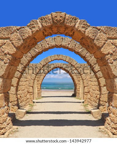 Ancient arch to the sea - stock photo