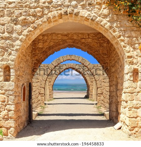 Ancient arches to the sea  - stock photo