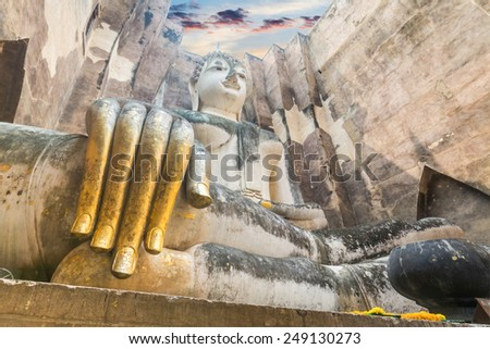 ancient architecture of Buddhist temples in Sukhothai Historical Park. Statue of Buddha Phra Achana at Wat Si Chum , Thailand - stock photo