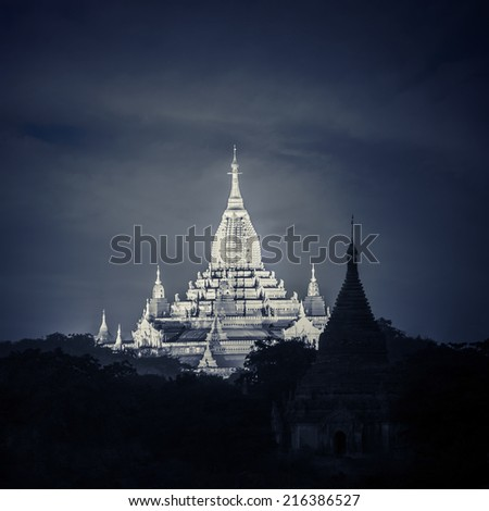 Ancient architecture of old Buddhist Temples at Bagan Kingdom. Night view of Ananda Pagoda one of the biggest and most important buddhist shrine in Myanmar. Travel landscape and destinations - stock photo