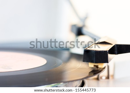 ancient audio disc while playing focus on a phonograph needle - stock photo