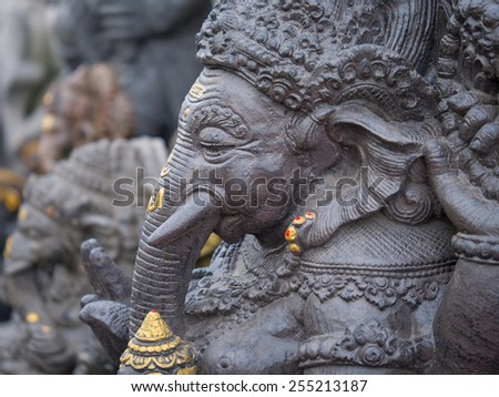 Ancient Balinese statue at the temple in Bali Indonesia - stock photo