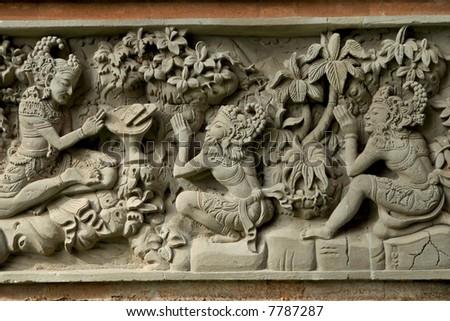 ancient bas relief at bali hindu temple - stock photo
