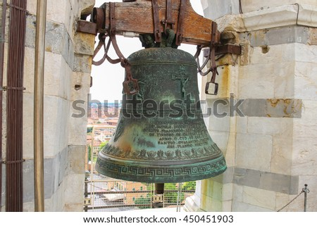 Ancient bell at the top of Leaning Tower in Pisa, Italy. - stock photo