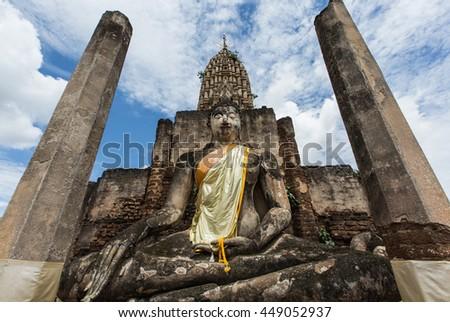 Ancient big buddha image and ruin city at Wat Phra Si Ratanamahathat, Sukhothai historical park ,UNESCO world heritage site, Sukhothai, Thailand - stock photo