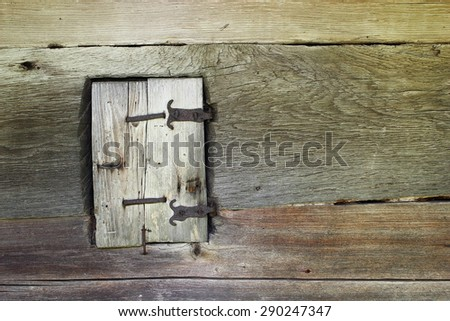 ancient blind on window, facade of old wooden church, detail - stock photo
