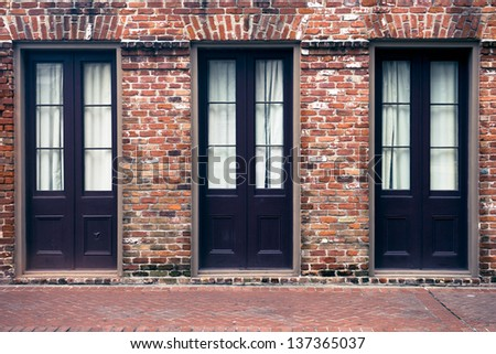 Ancient brick building in the French Quarter of New Orleans - stock photo