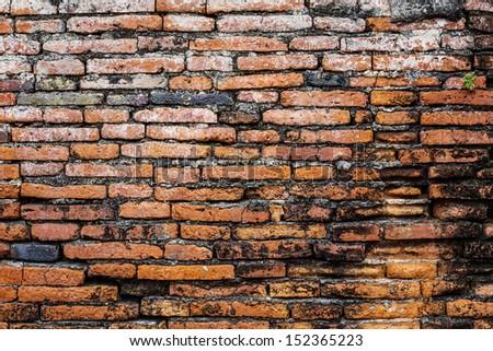 Ancient brick wall - stock photo