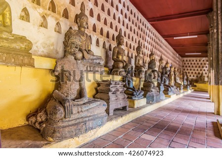 Ancient Buddha Art in wat Sisaket, Vientiane, Laos. - stock photo