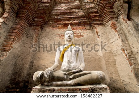 Ancient Buddha at Prasat Nakhon Luang - stock photo
