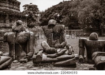 Ancient buddha statue - stock photo