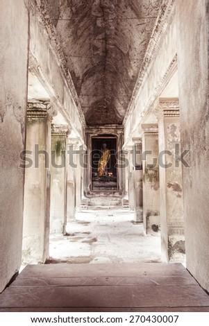 Ancient Buddha statue in Angkor Wat ruins, Siem Reap, Cambodia. - stock photo