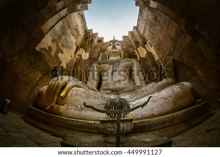 Ancient buddha statue. (Phra Achana, Wat Si Chum) Si Chum temple, Sukhothai Historical Park, Sukhothai Province, Thailand - stock photo