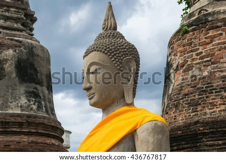 Ancient buddha statue with old pagoda,  - stock photo
