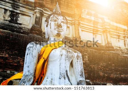 Ancient Buddha under sunlight - stock photo