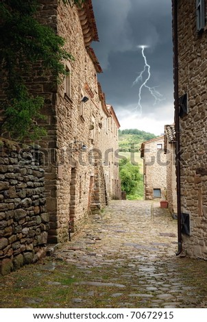 ancient building under cloudy sky - stock photo
