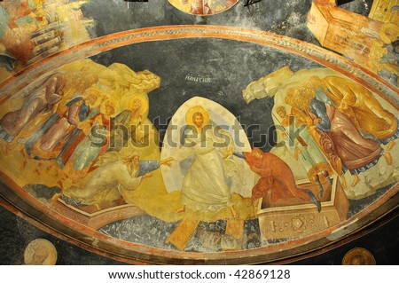 Ancient byzantine fresco of Jesus raising Adam and Eve from their tombs on the half dome of the church of saint chora in constantinople - stock photo