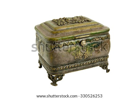 Ancient casket made copper-tin box on legs for storing jewelry - stock photo