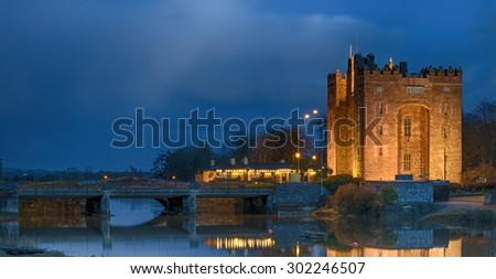 ancient castle by a river in county clare ireland - stock photo