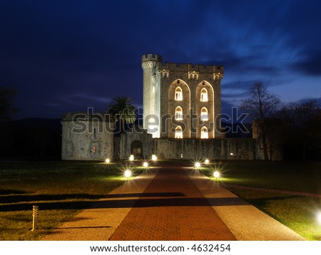 Ancient castle tower at dusk - stock photo