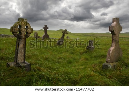 Ancient Celtic gravesite with unmarked gravestones in the middle of a meadow in rural Scotland. - stock photo