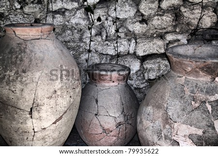 ancient ceramic pitchers at the wall - stock photo