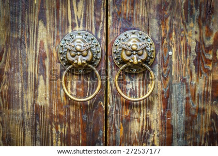 Ancient Chinese knocker. Located in Old Town of Lijiang, Yunnan province, China. - stock photo