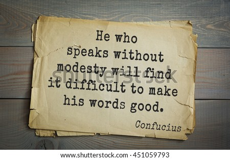 Ancient chinese philosopher Confucius quote on old paper background. He who speaks without modesty will find it difficult to make his words good. - stock photo
