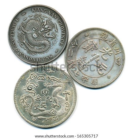 Ancient chinese silver coins isolated on white - stock photo