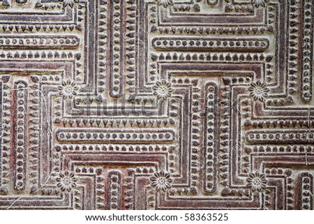 Ancient circuit stone carving - stock photo