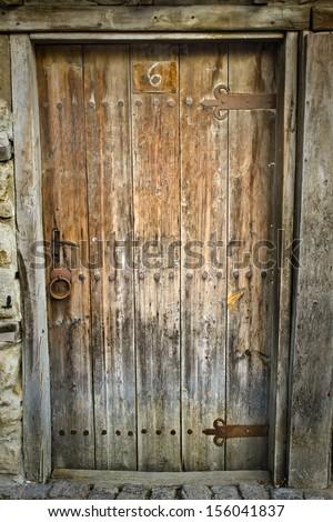 Ancient closed and forgotten doorway/Old wooden door background - stock photo
