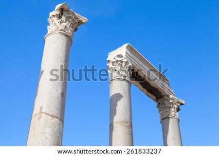 Ancient columns and portico fragment on blue sky background, fragment of ruined roman temple in Smyrna. Izmir, Turkey - stock photo