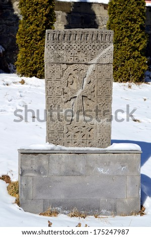 Ancient cross-stones or khachkars in Vanadzor city, Armenia. Khachkars are carved memorial stele, covered with rosettes and other patterns, unique art of Medieval Christian Armenia. - stock photo