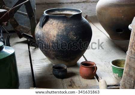 Ancient domestic scene with vintage pottery  - stock photo